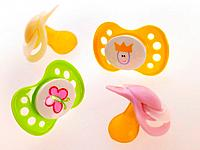 Close_up of four pacifiers