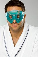 Mid adult man wearing eye mask