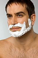 Close_up of mid adult man shaving, portrait