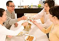 Mature adult couples having meal together, Side View, High Angle View