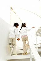 Photography of a boy and girl walking up the stairs, Low Angle View