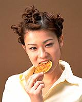 A Woman Eating Rice Cracker, Front View