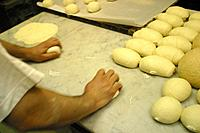 Baker Forming Bread Rolls