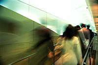 People walking down passage, rear view, blurred motion, Tokyo, Japan