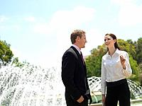 A Pair of Talking Office Workers by the Fountain
