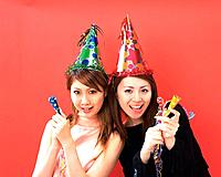 Two Young Women Having a Party, Front View, Looking at Camera