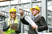 Young woman and construction Manager