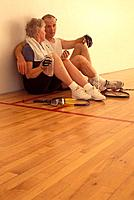 Older Couple Taking A Break On The Racquetball Court