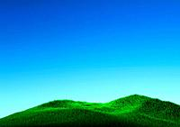 Grassy hill and blue sky