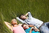 A family sleeping in a field (thumbnail)