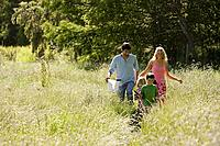 A family walking through a field