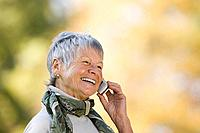 Smiling senior woman using a cell phone (thumbnail)