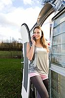 A teenage girl using a cell phone (thumbnail)