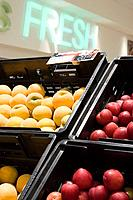 Peaches and plums in supermarket