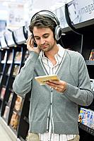 Man listening to music in supermarket