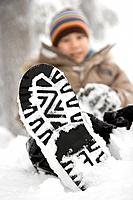 Boy with snow on his shoe