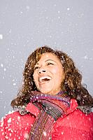 A woman laughing in the snow