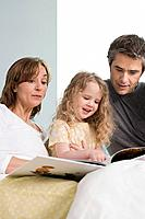 A family reading a book