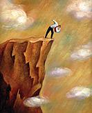 Businessman looking down over the edge of a cliff