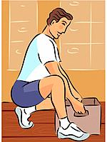 Man bending his knees to lift a heavy box