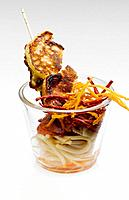 Fried Turkey piccata with linguini noodles in glass