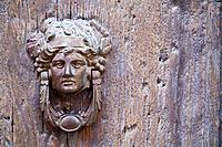 Wooden door with knocker, close_up
