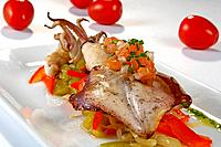 Grilled squid with piperrada sautéed peppers and vegetables