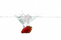 Strawberry dropped into water