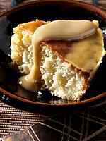 A slice of south african malva pudding editoral food
