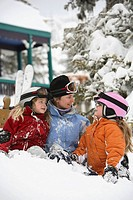 Mother and two daughters playing in snow at Silver Star Mountain Resort, Vernon, British Columbia, Canada.