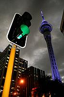 Traffic light and Skytower and dark sky in Auckland City, Auckland, North Island, New Zealand