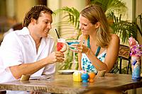Hawaii, Maui, Wailea, Tommy Bahama´s Tropical Cafe, Caucasian couple enjoying drinks together.