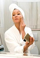 young woman in bath takes face powder