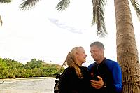 Couple ages 26 and 39 gearing up for scuba diving  Beqa Island, Fiji