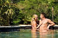 Couple ages 26 and 39 enjoying a wonderful holiday at a tropical resort  Poolside Beqa Lagoon Resort, Beqa Island, Fiji