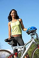 Young woman with bicycle outdoors portrait