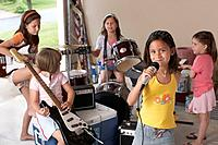 Group of girls 7_9 with instruments in garage