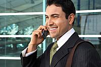 Businessman using mobile phone outdoors