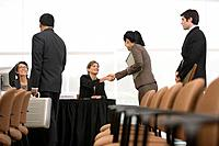 Businesspeople Greeting at Conference