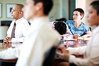 Businessman with Head Down in Meeting
