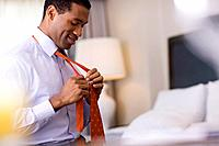 Businessman Getting Dressed in a Hotel Room