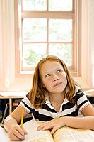 Girl thinking at desk