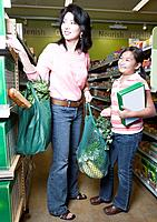 Asian mother and daughter shopping in health food store