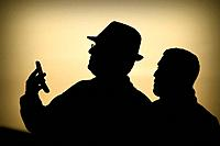 Silhouettes talking on the phone