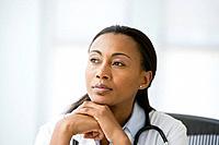 Hispanic female doctor thinking