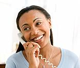 Hispanic woman talking on telephone