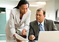 Multi_ethnic businesspeople looking at paperwork