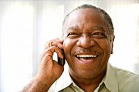 Senior African man talking on cell phone