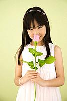 Asian girl smelling flower