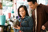Asian couple in pottery shop